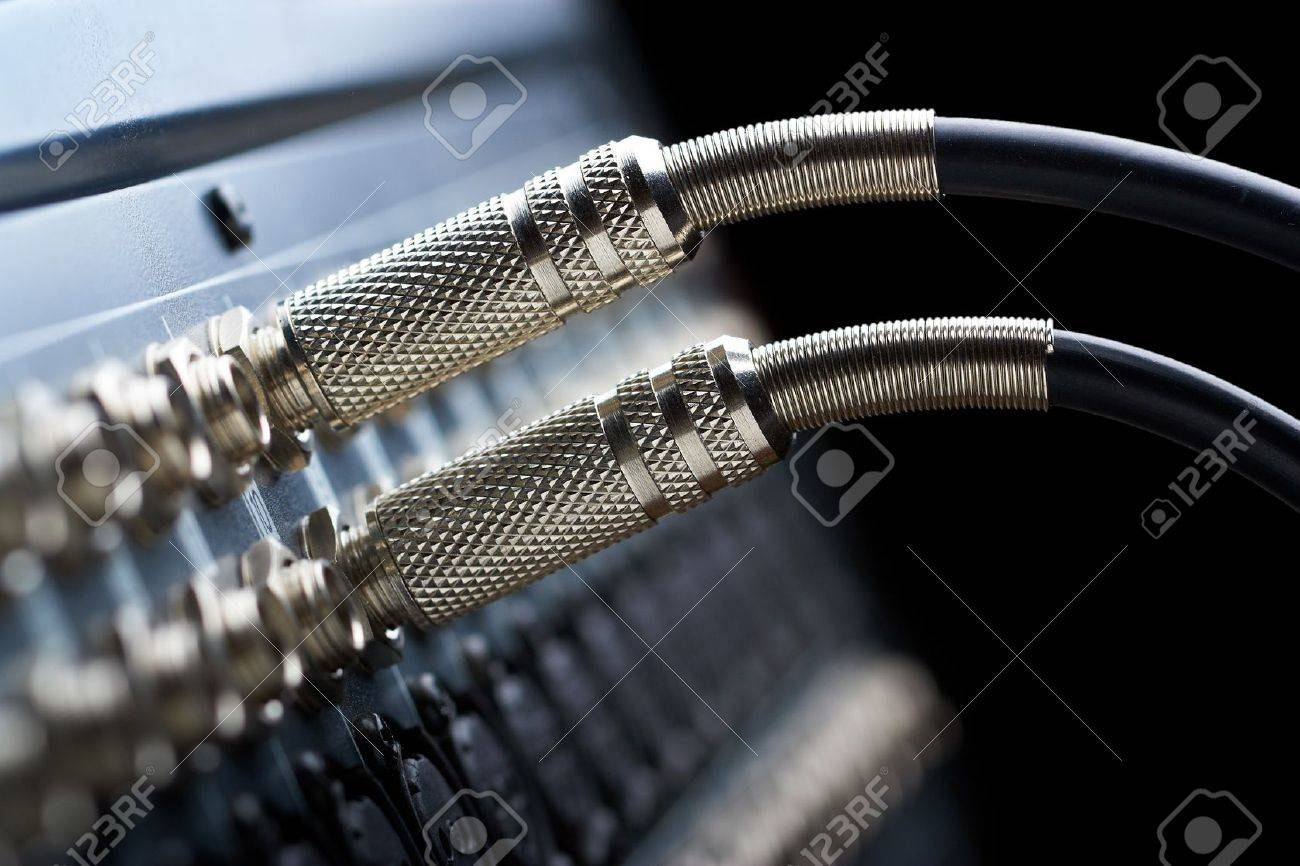 Two connectors is connected to audio mixer Stock Photo - 15951919
