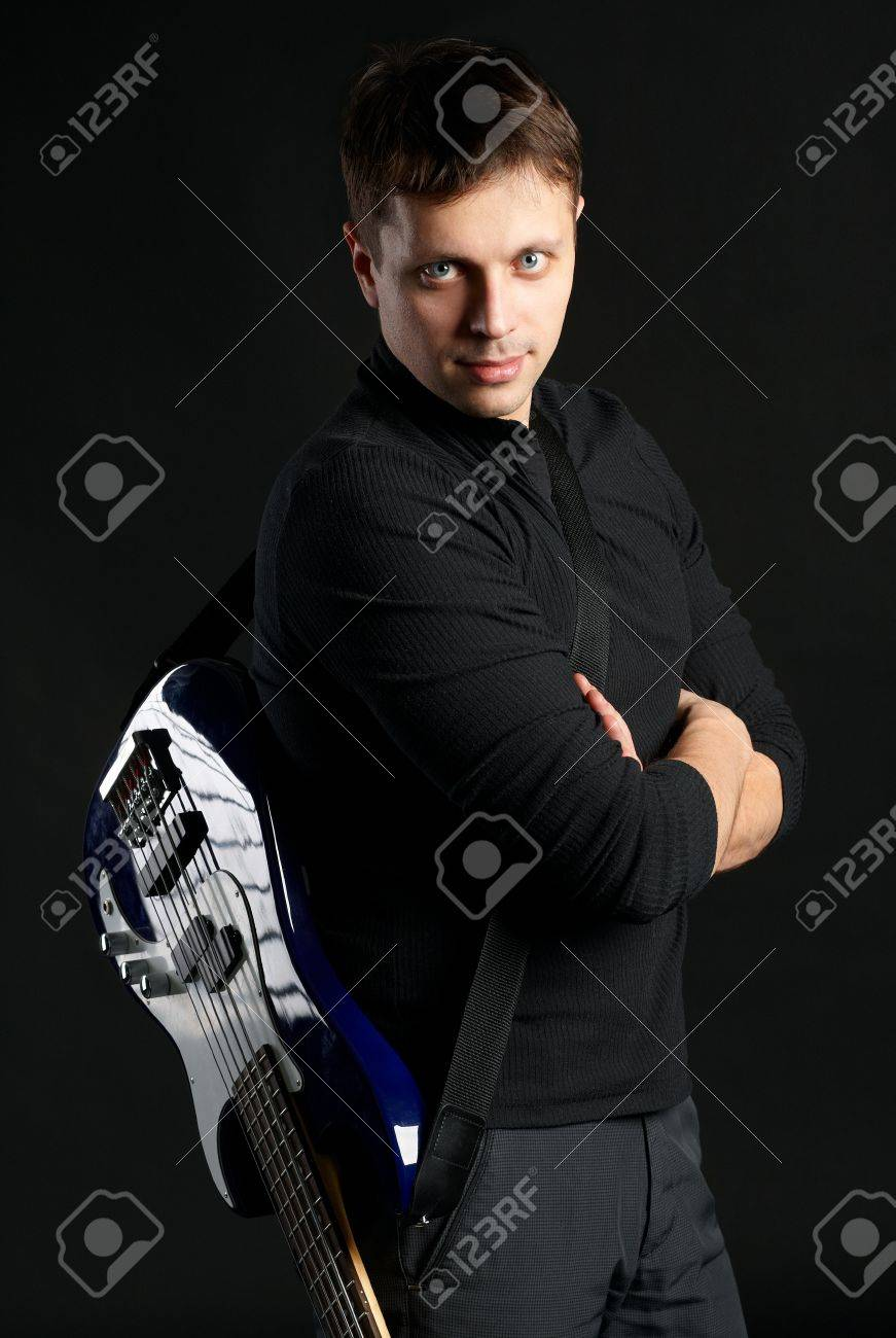 Guy with a guitar on a black background Stock Photo - 15980985