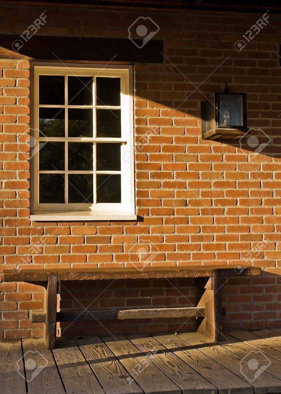 A Wooden Bench White Paned Window And A Brick Wall In Front Stock Photo Picture And Royalty Free Image Image 3124592