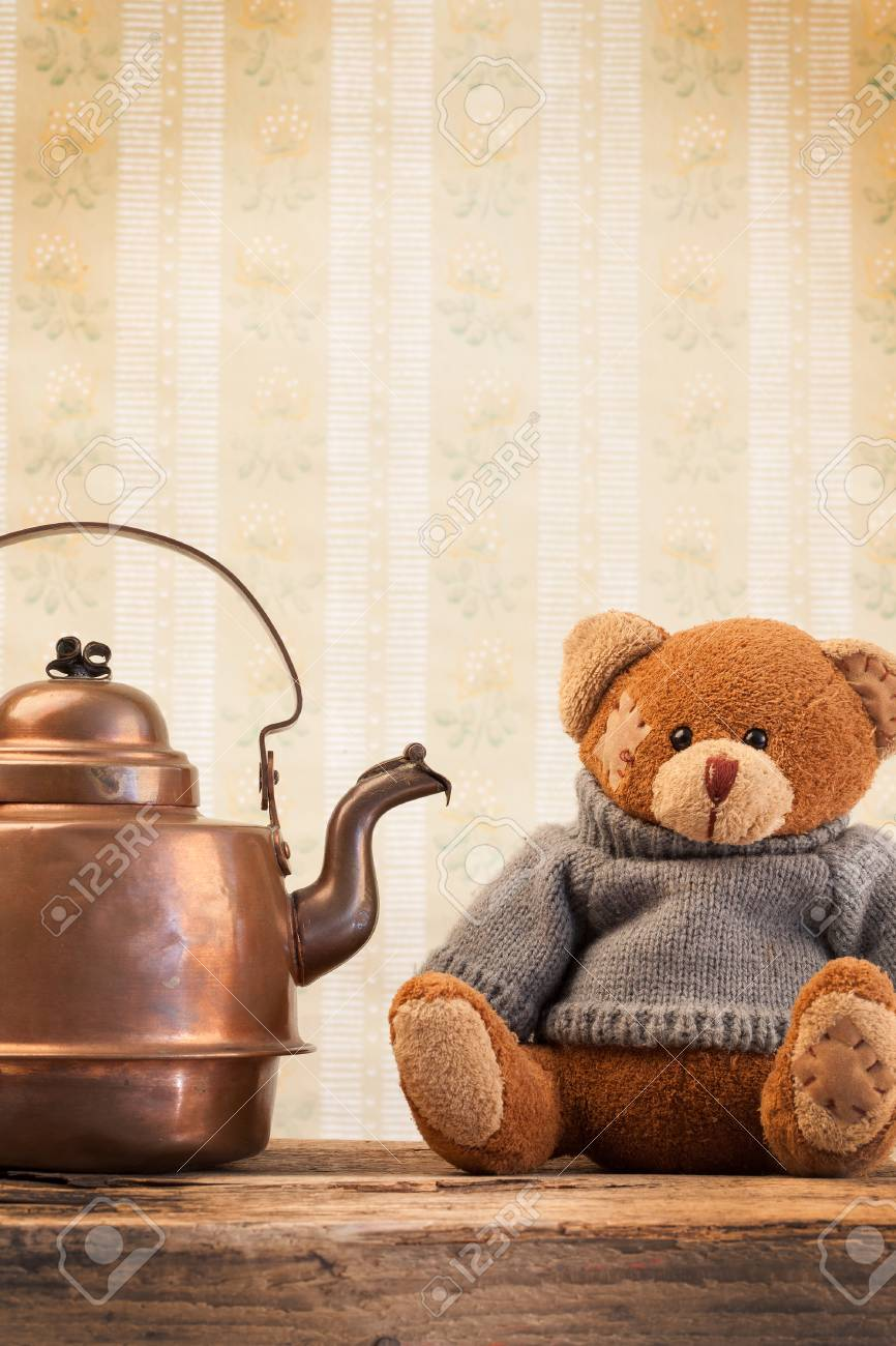 Teddy Bear And Vintage Copper Kettle On The Background Of Old