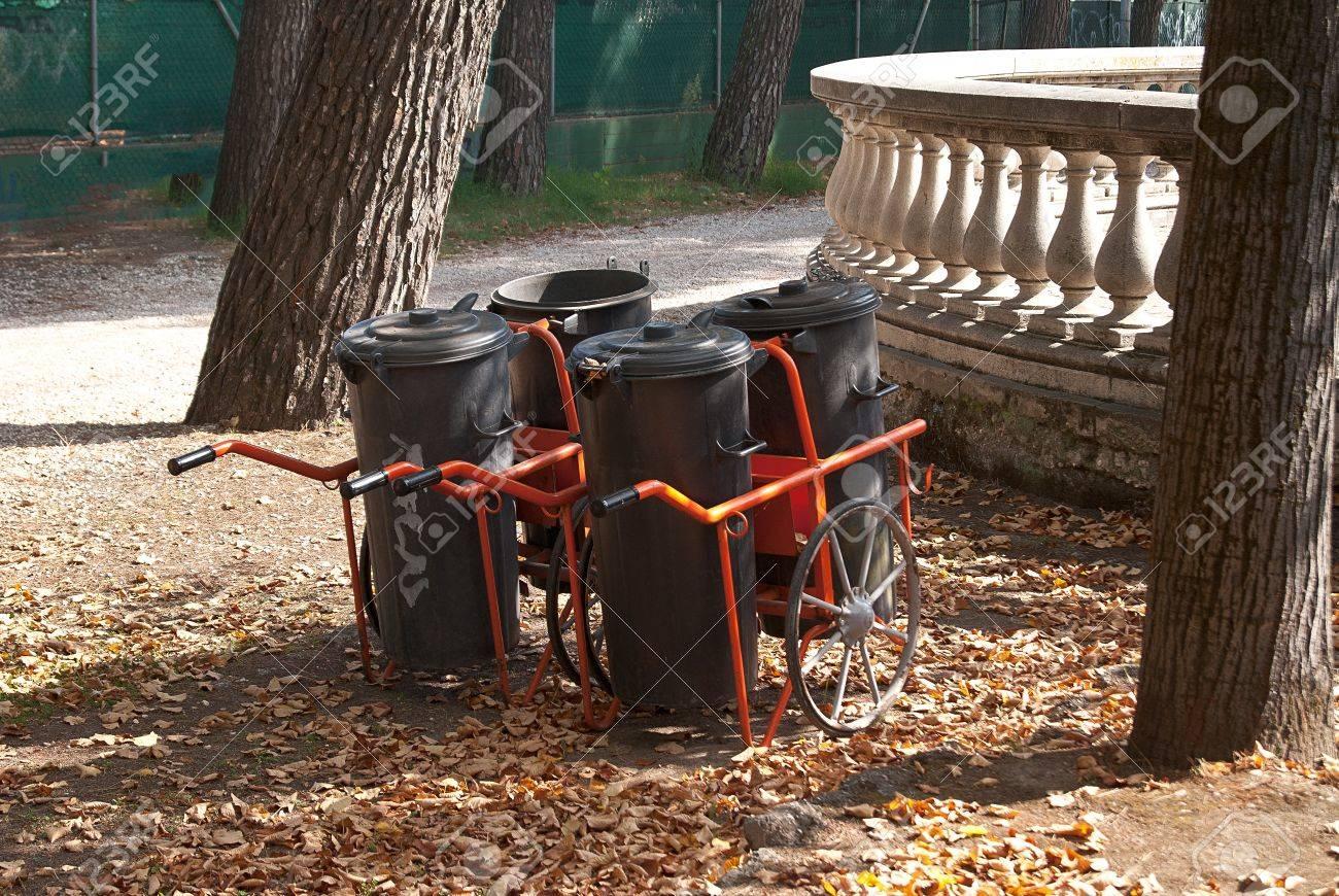 Black environmental garbage bins with red handles Stock Photo - 16984337