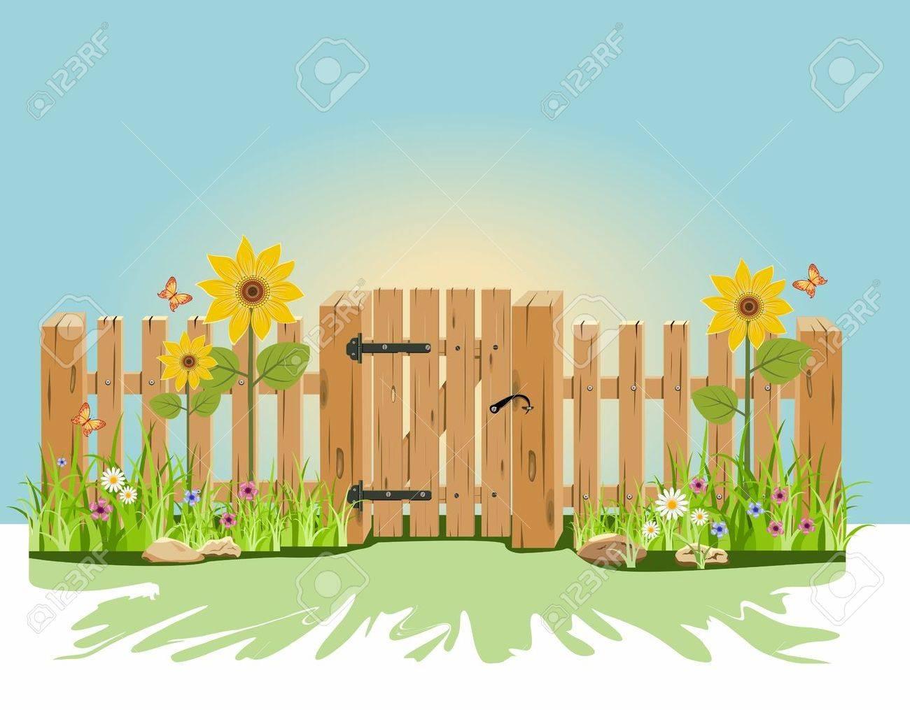 Eine Hölzerne Tor Und Zaun Mit Grünem Gras Und Blumen Lizenzfrei