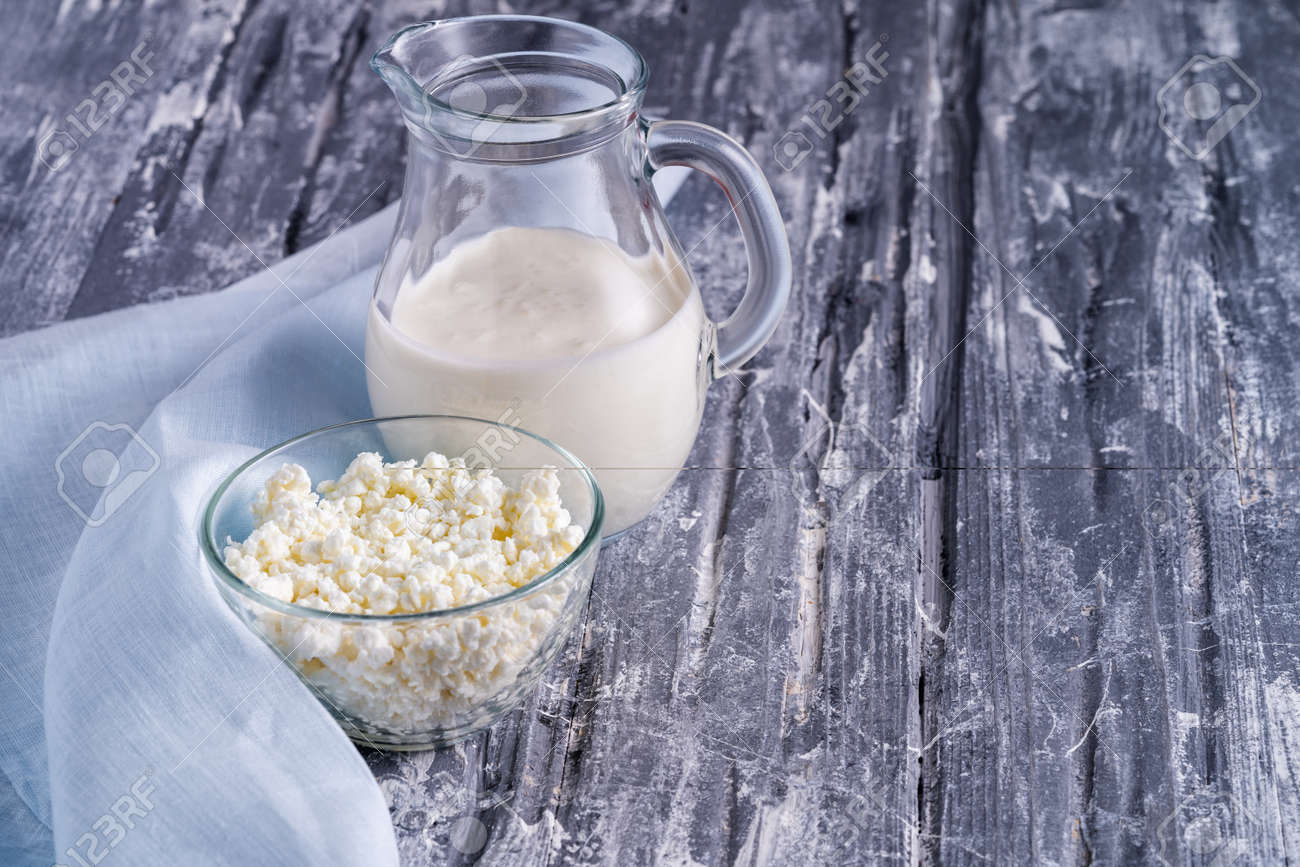 Fermented drink kefir in a glass and curd cheese in a glass bowl. - 144649781