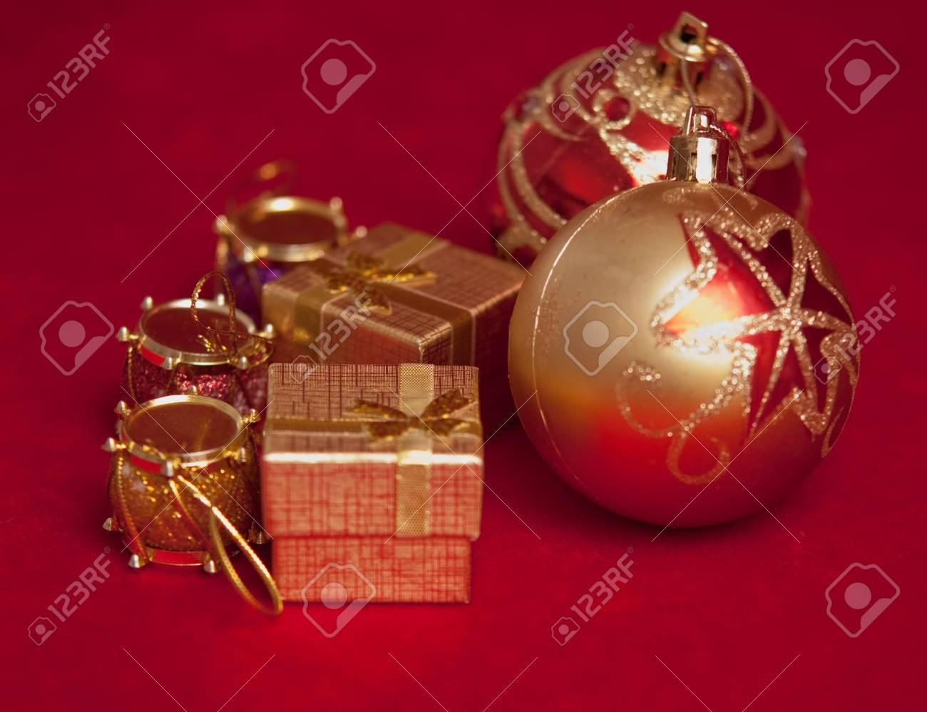 Varicoloured christmas balls on red  background  . Stock Photo - 9554380