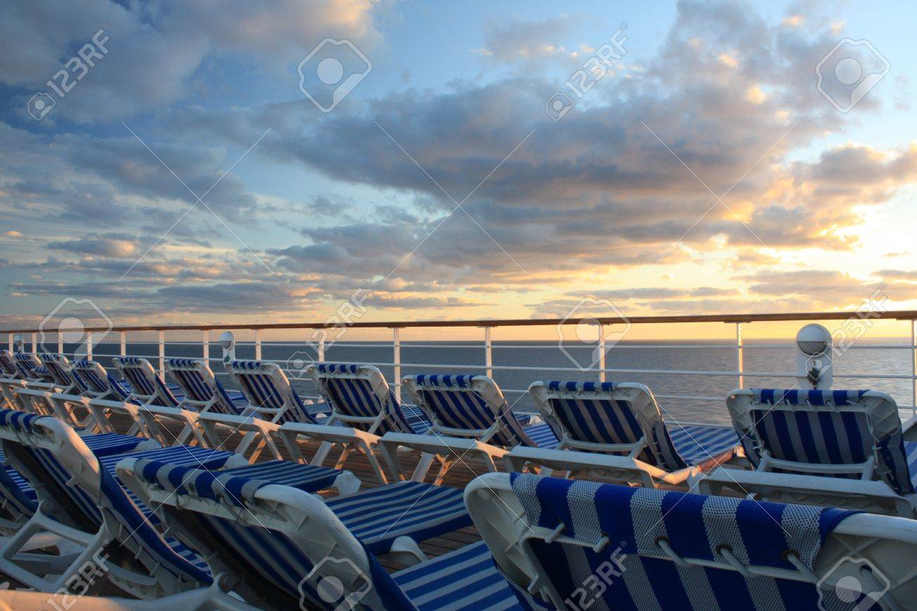 Cruise Deck Beach Chairs With Ocean Sunset Background Stock Photo