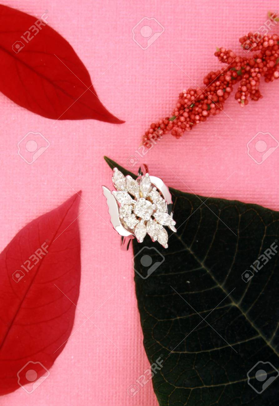 Closeup Of A Diamond Wedding Ring With Red And Green Leaves Isolated ...