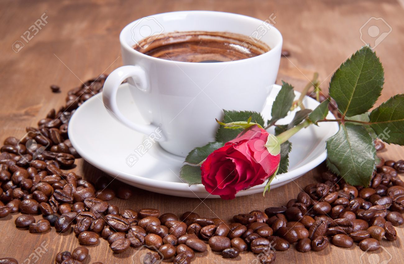 White cup of black coffee with coffee beans and red rose - 8793931