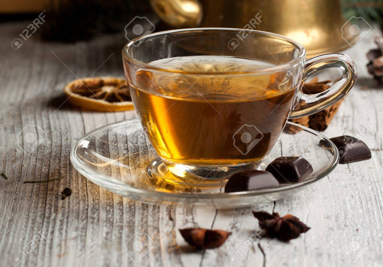 Cup Of Hot Tea With Dark Chocolate On Old Wooden Table Stock Photo ...