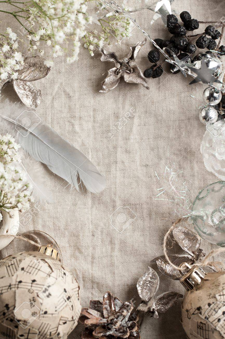 Background with white gypsophila flowers and christmas toys on linen cloth Stock Photo - 11525782