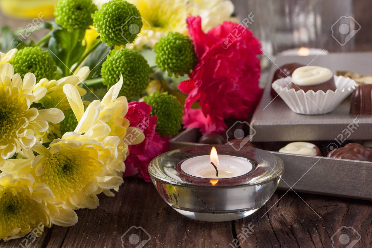 Chocolate Candies Lightning Candle And Bouquet Of Carnation Stock