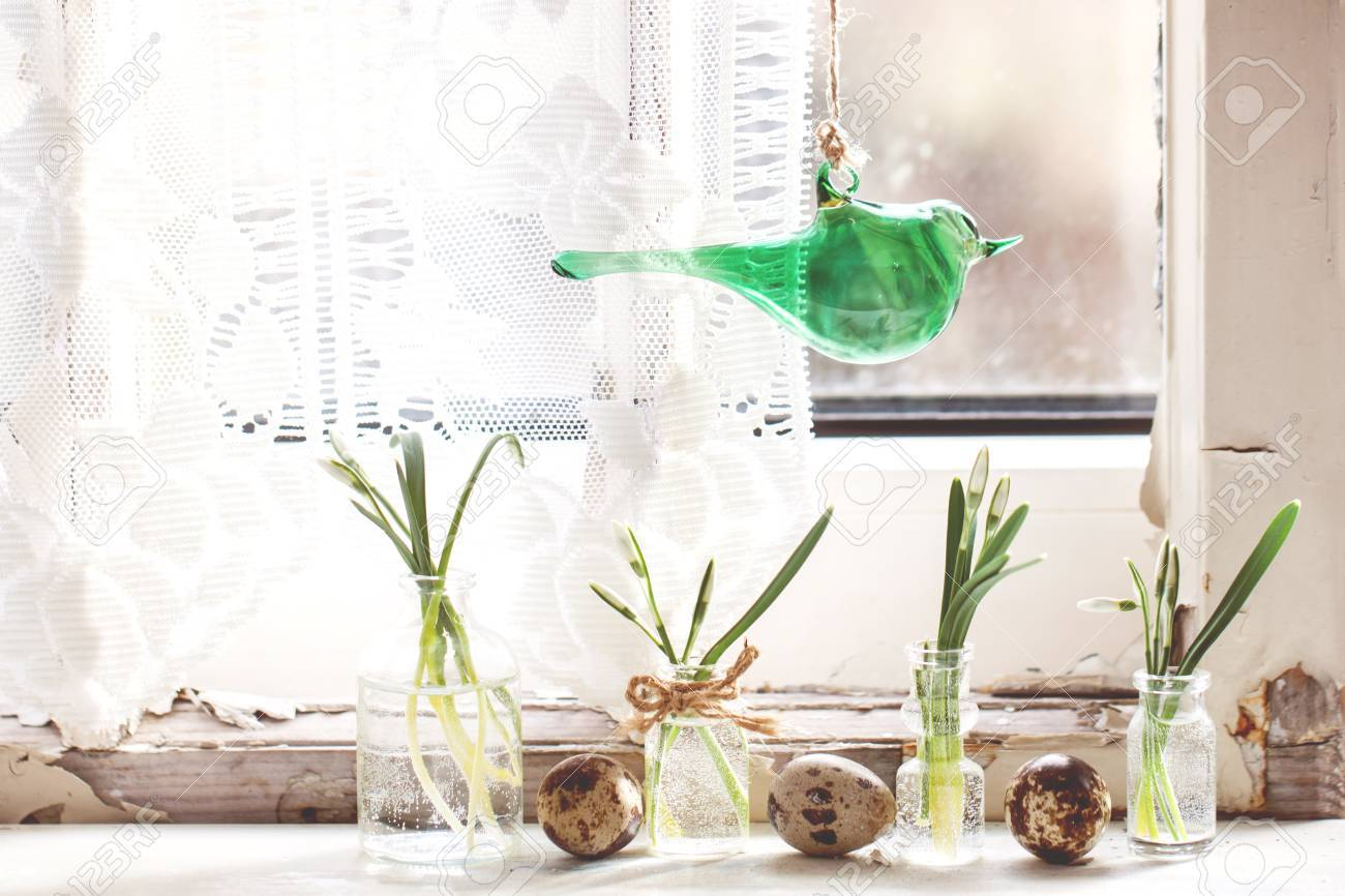 Fragment of Easter interior on ols windowsill with little glass