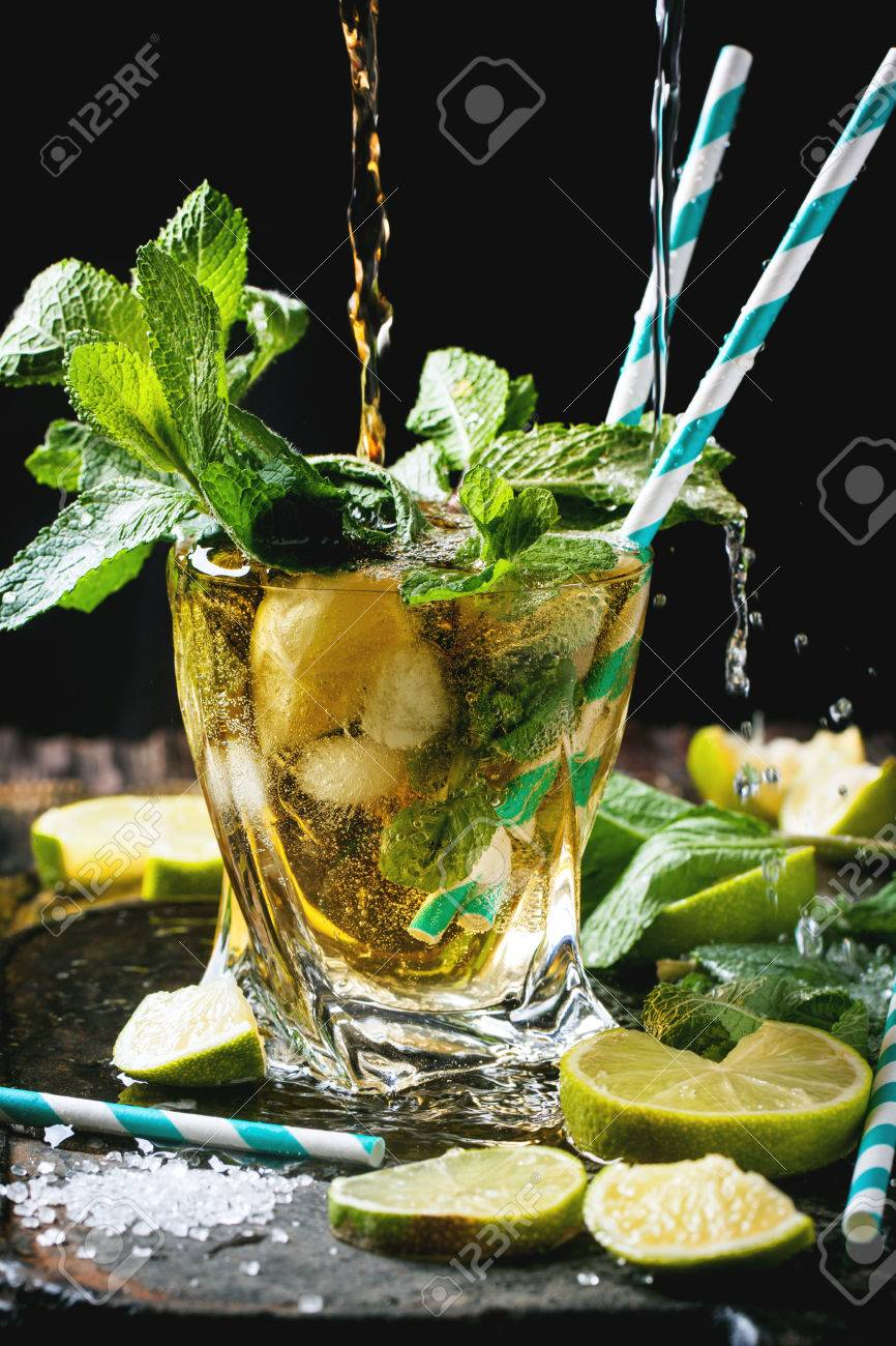 Glass Of Mojito Cocktail With Pouring Rum And Soda Fresh Mint