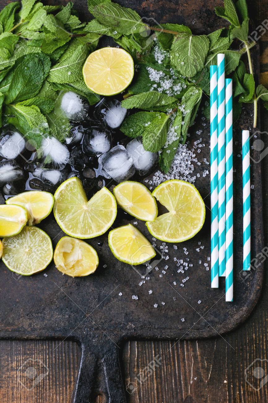 Ingredients for mojito (fresh mint, limes, ice, sugar) with retro
