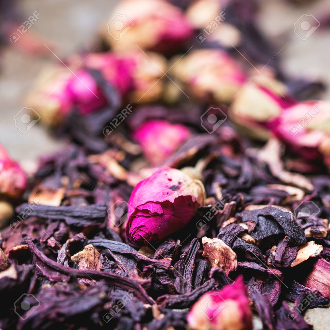 Heap of tea roses and dried hibiscus flower square image with heap of tea roses and dried hibiscus flower square image with selective focus stock photo izmirmasajfo