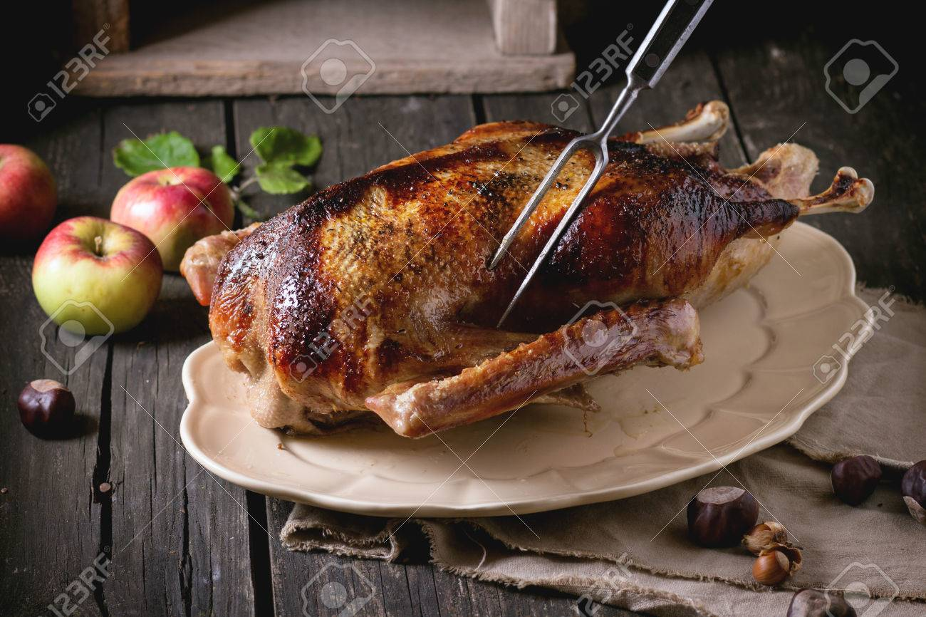 Stuffed Goose. Baked goose with apples and buckwheat in the oven 85