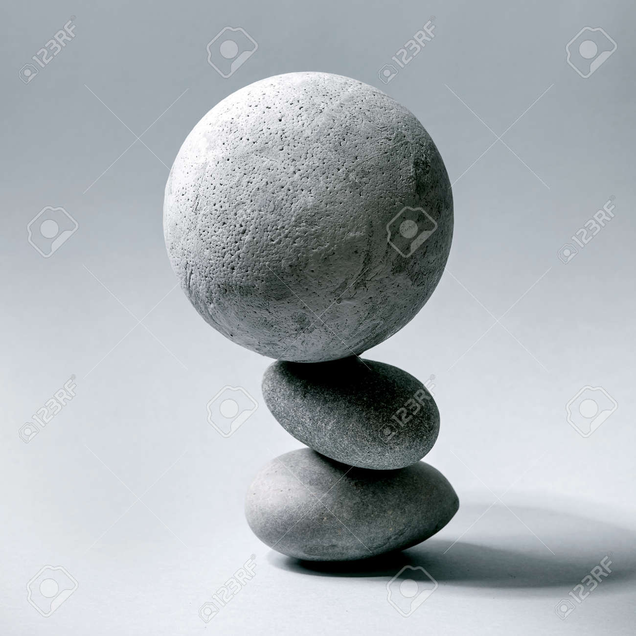 Abstract background with composition of balanced grey geometric objects sphere and stones. Copy space. Modern concept for product presentation. Square - 171903237