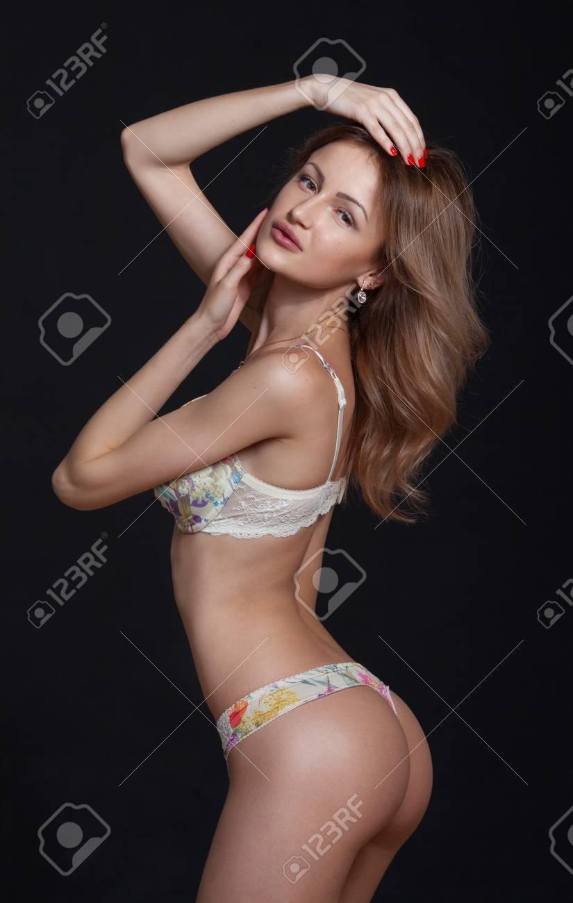 sexy attractive blonde woman posing in elegant lingerie. studio