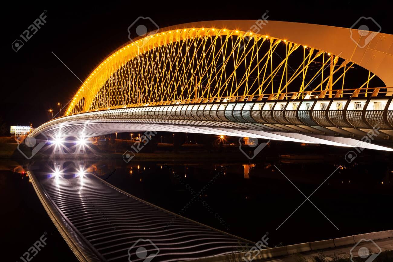 Modern bridge construction in night - 146590737