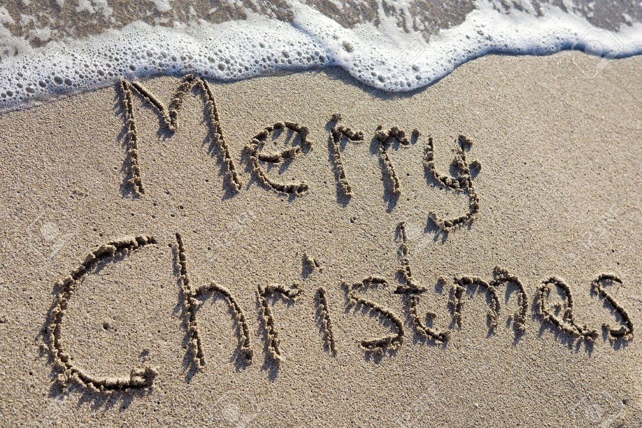 Merry Christmas Written On The Sand Stock Photo, Picture And ...