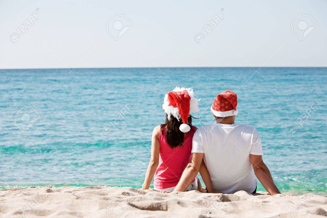 Christmas Couple In Love On The Beach Stock Photo, Picture And ...
