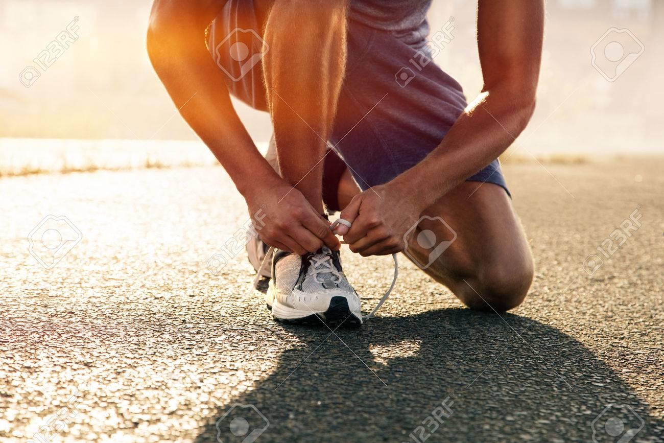 Runner ties his shoes - 75867264