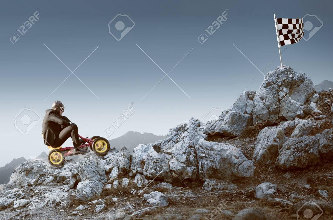 Businessman on a pedal car - 76941222
