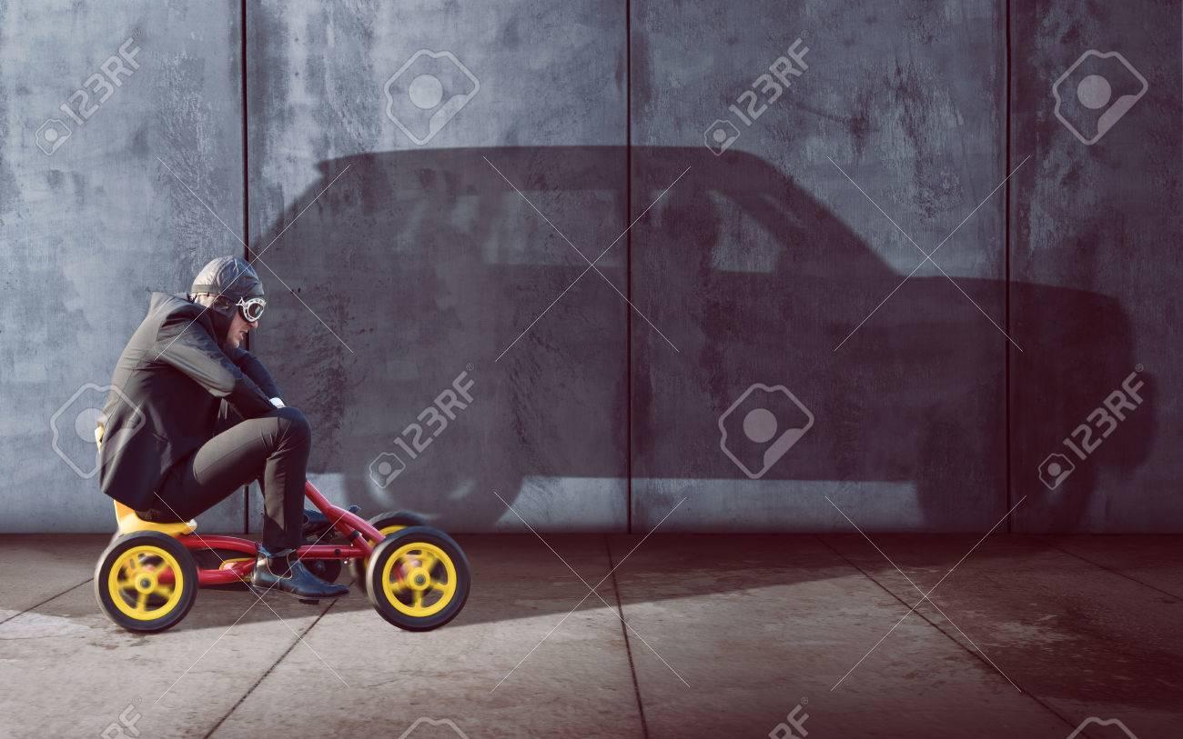 Ambitous Businessman on a pedal car - 76941227