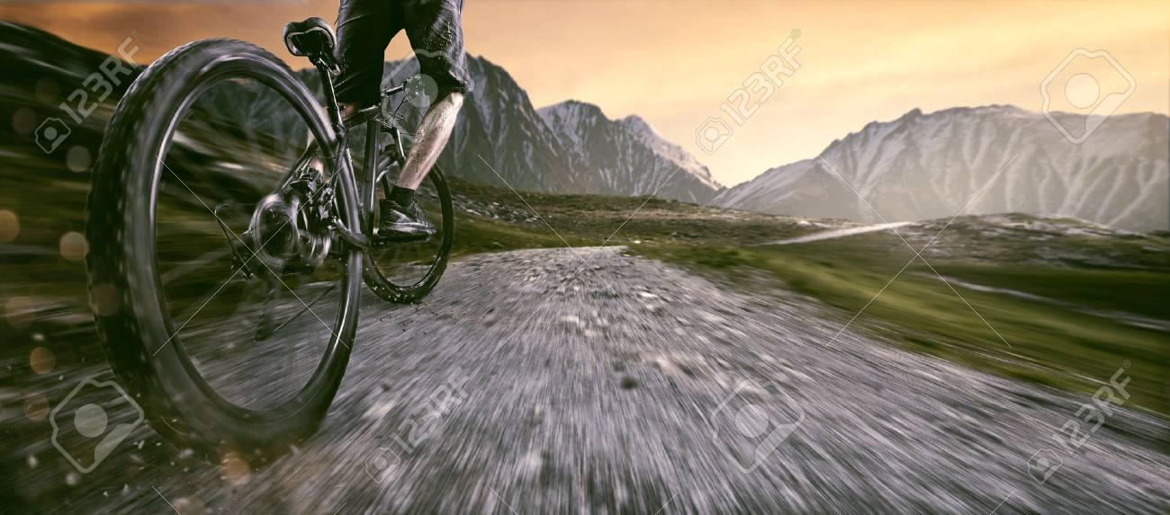 Mountainbiker goes uphill - 76941224