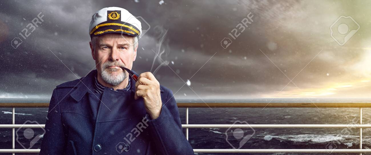 old Captain with smoking pipe - 93563129