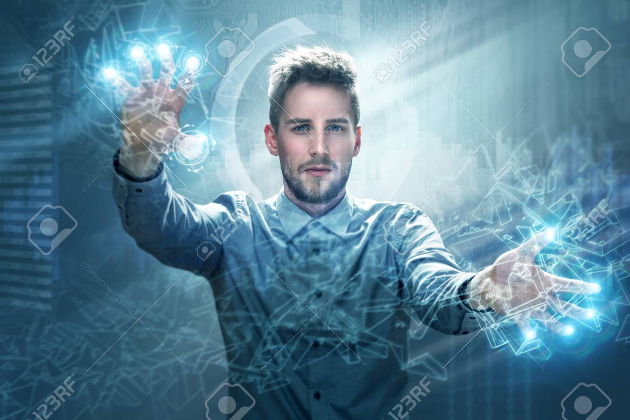 Man working on a touchscreen interface - 76974375