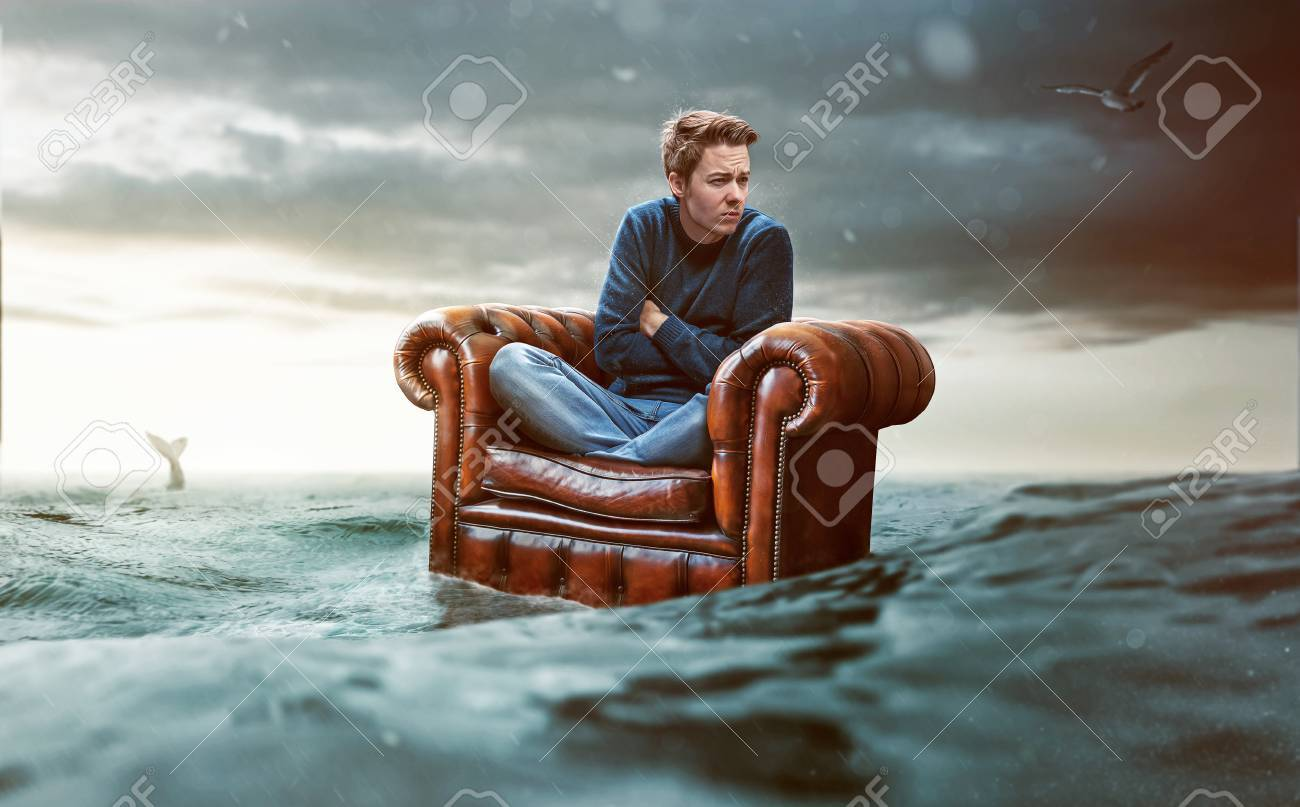Man on a seat lost at sea - 76986908
