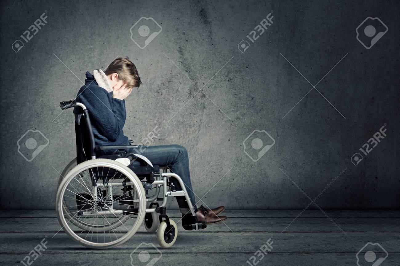 Sad man in wheelchair - 76986566