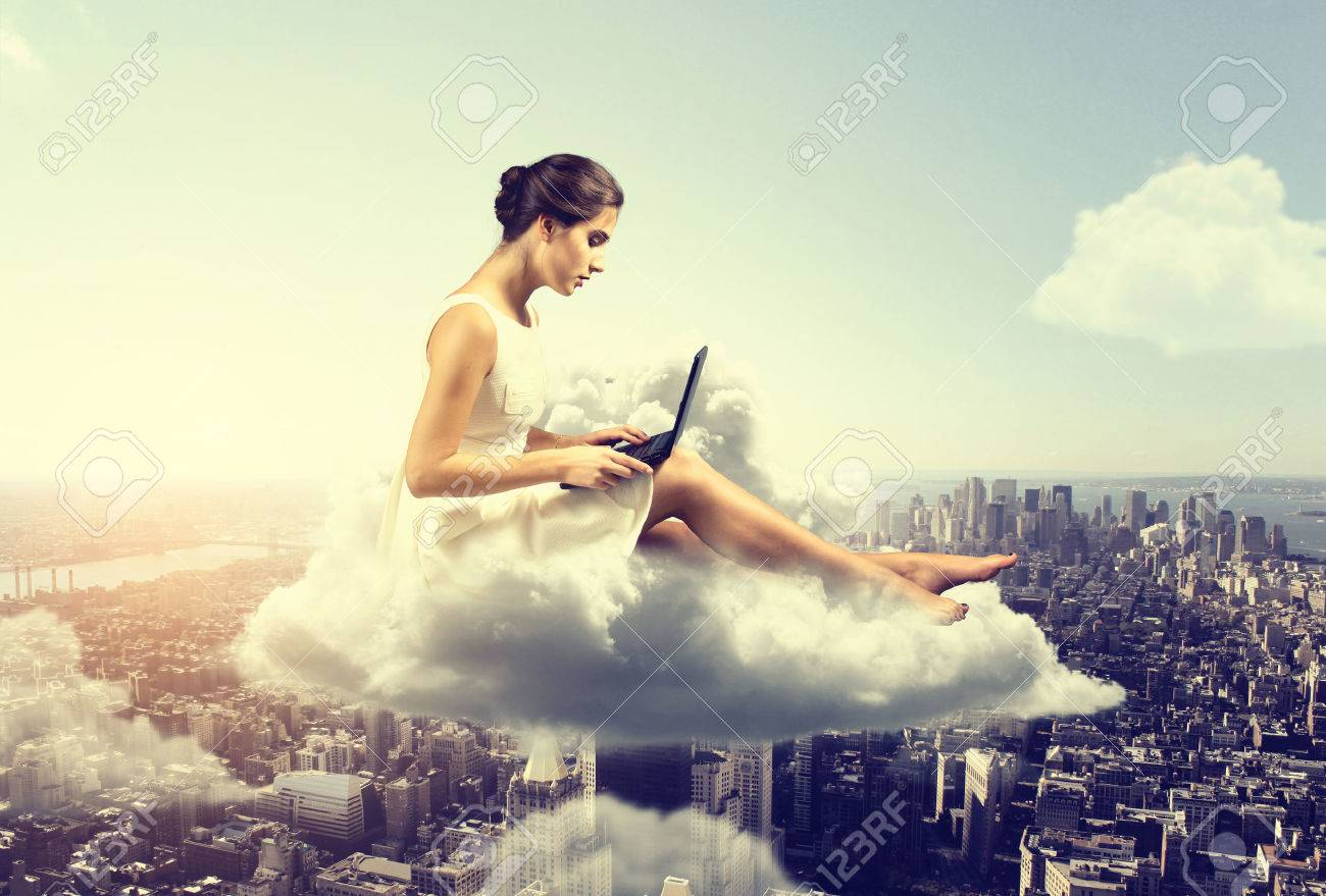 Woman working o a cloud above the city - 77466335