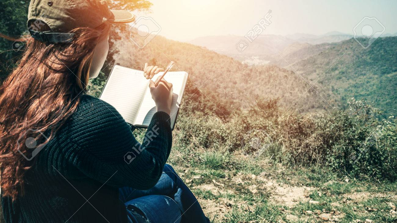 Women write notes Nature trails, mountains, forests. Writer - 75397392