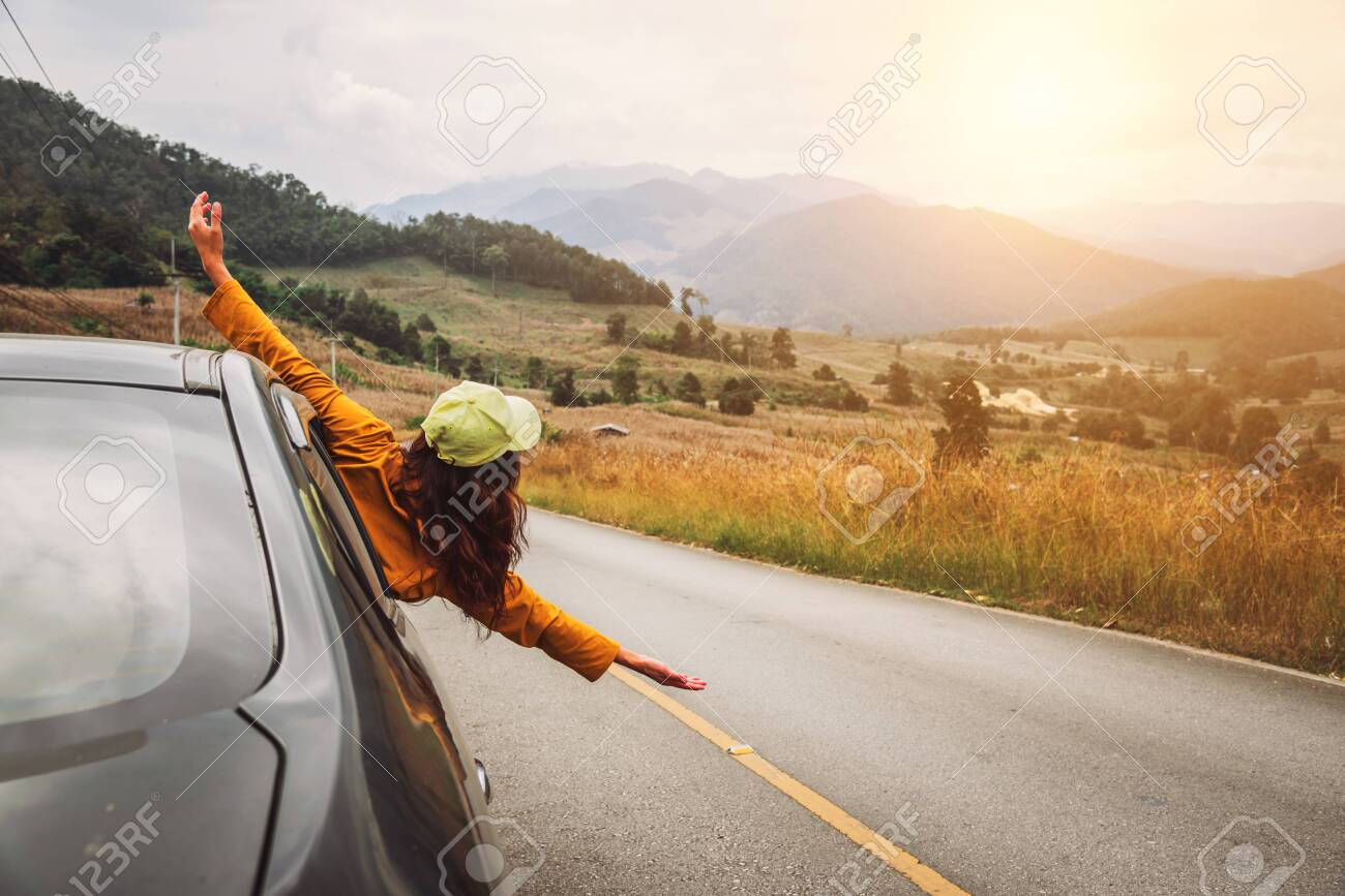 Asian women travel relax in the holiday. driving a car traveling happily. - 127407869
