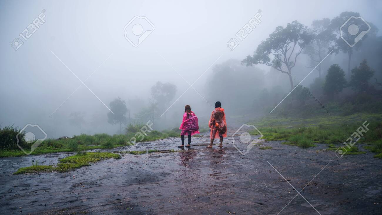 Couples Tourist With Rain Coat Walking Travel Adventure Nature Stock Photo Picture And Royalty Free Image Image 127416890
