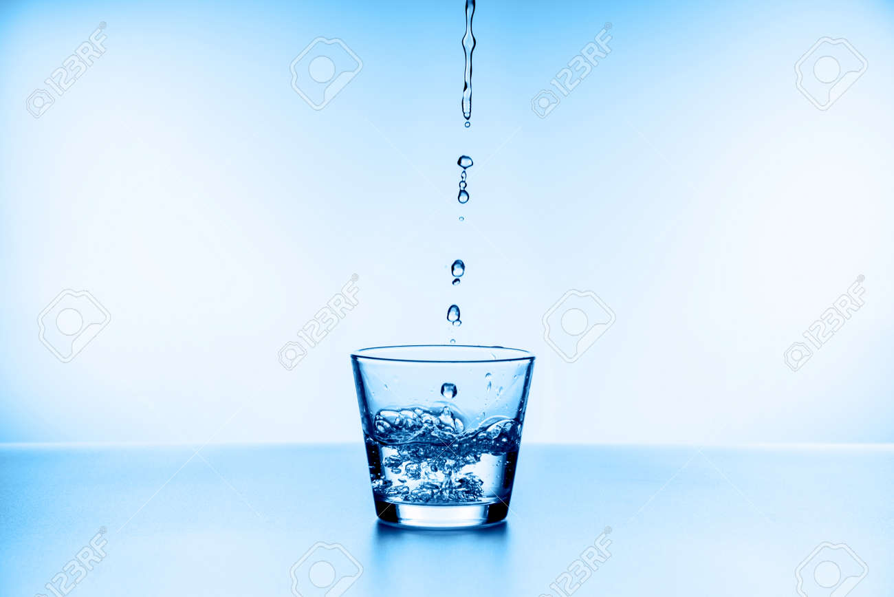 water splashing from glass isolated on blue background - 160518914