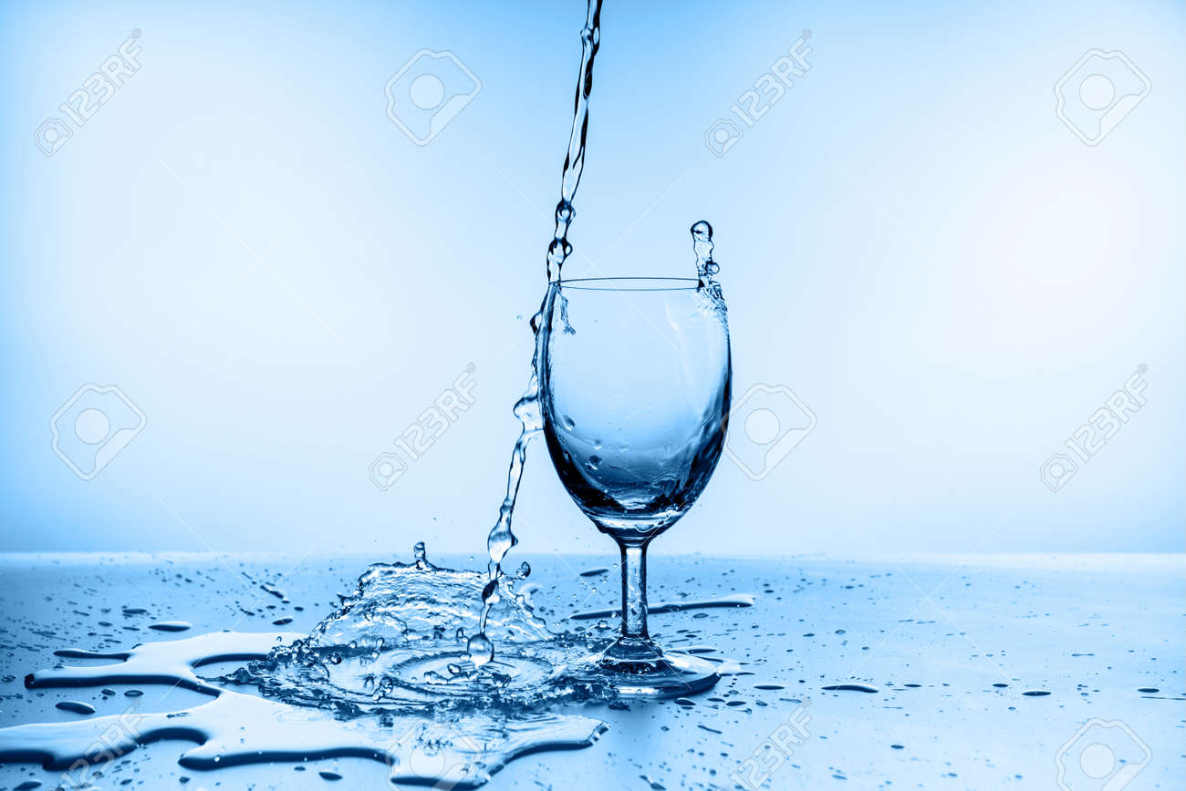 water splash collection in wine glass isolated on blue background - 160518963
