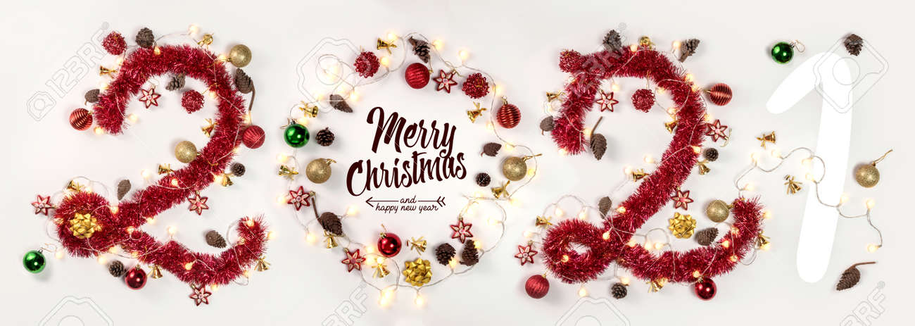 New Year 2021. Christmas. Holidays. Composition with Christmas and New Year garlands, numbers 2021 - 160500329