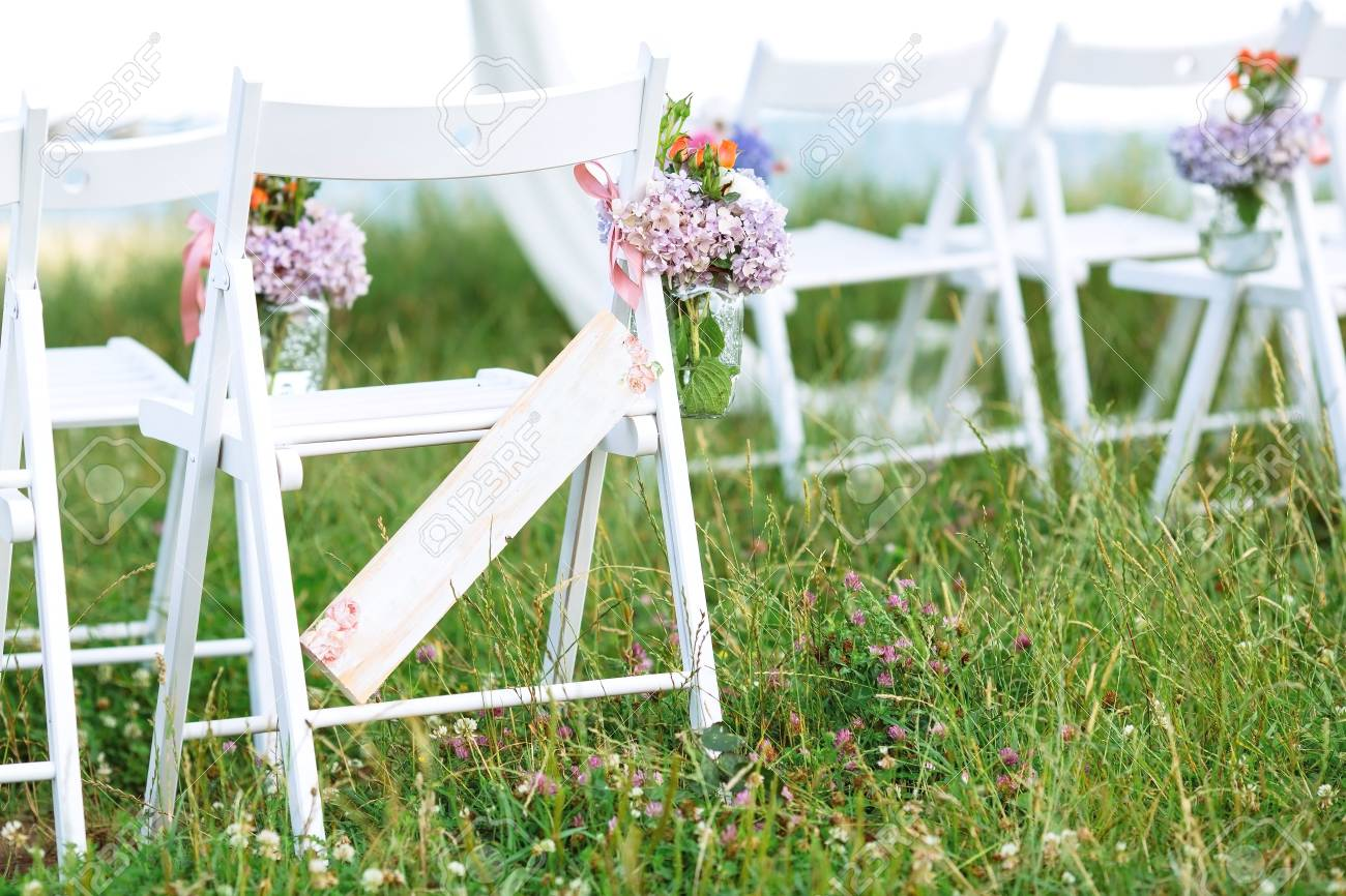 Beautifully Decorated White Chairs For Wedding Reception Outdoors Stock Photo Picture And Royalty Free Image Image 89883502
