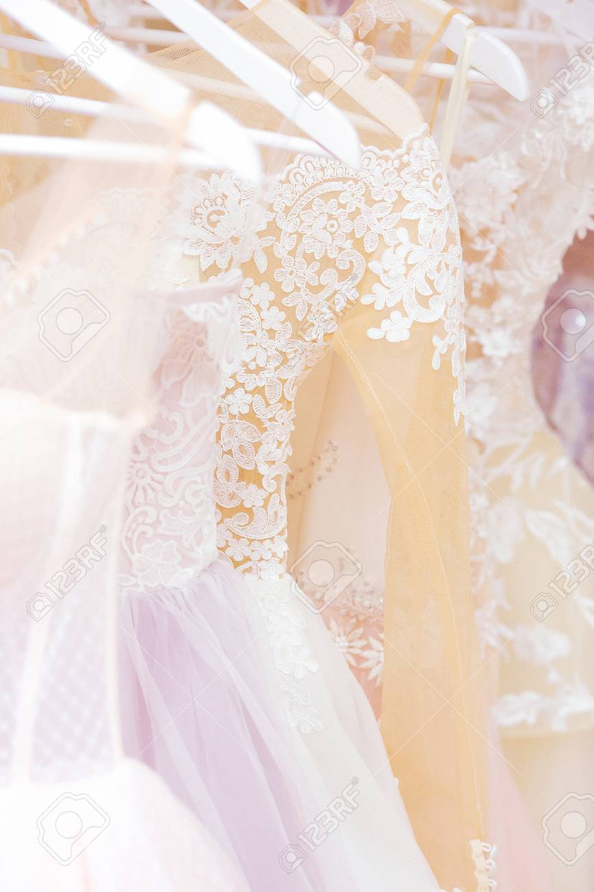 789680ad0 Wedding Dresses On White Hangers In Showroom Stock Photo, Picture ...