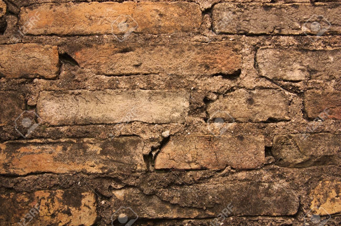 old brown brick wall background texture abstract pattern of stock