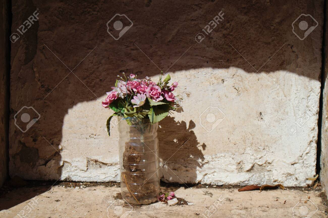 Niche With A Simple Bouquet Of Artificial Flowers Covered In Stock Photo Picture And Royalty Free Image Image 133834176