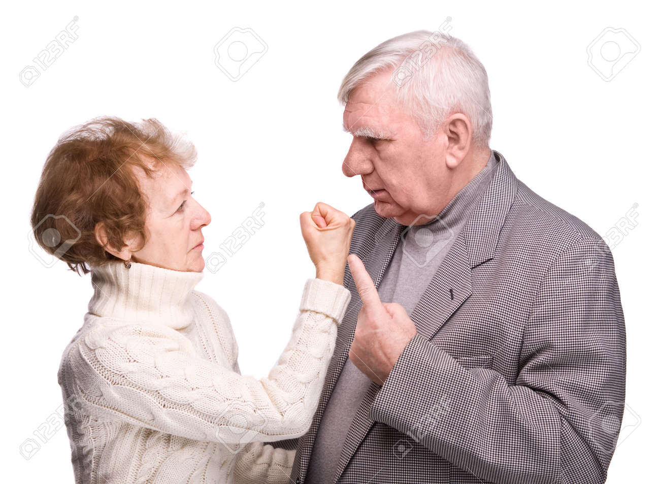 Conflict elderly couple on a white background Stock Photo - 6402562