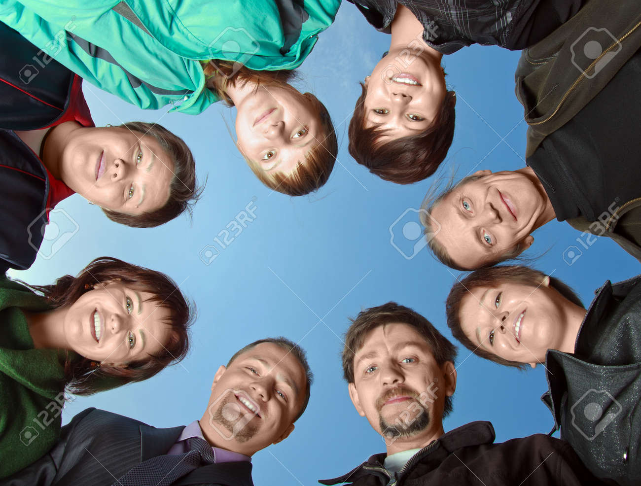 Group of eight people against the sky Stock Photo - 7940779