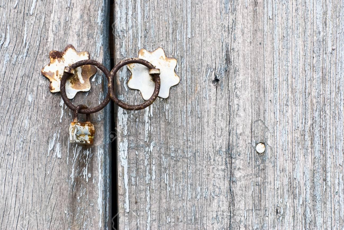 Old chinese doorknocker and wooden textured door Stock Photo - 5076544