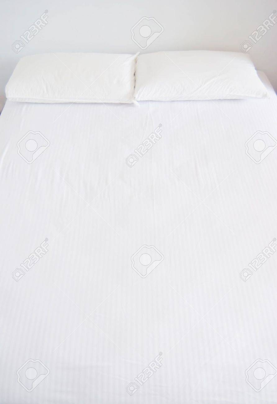 White bed pillows - Stock Photo White Pillows And Bed In White Bedroom