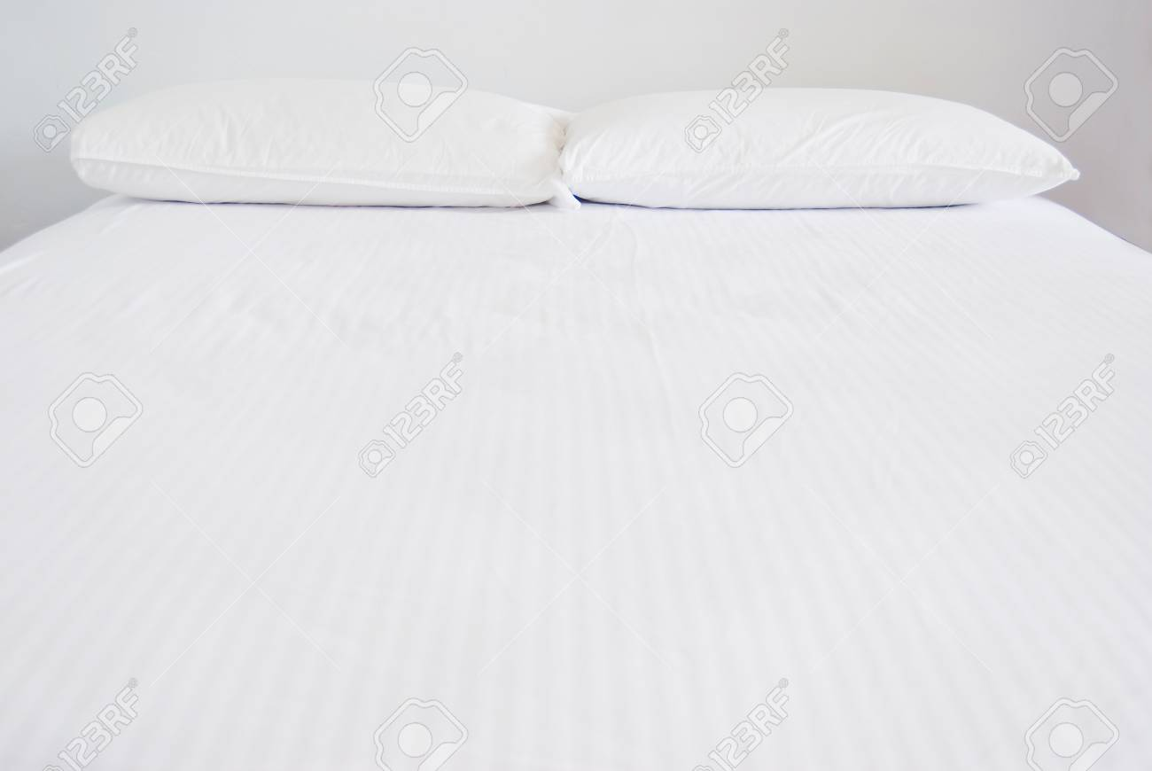 White pillows and bed in white bedroom Stock Photo - 8367372
