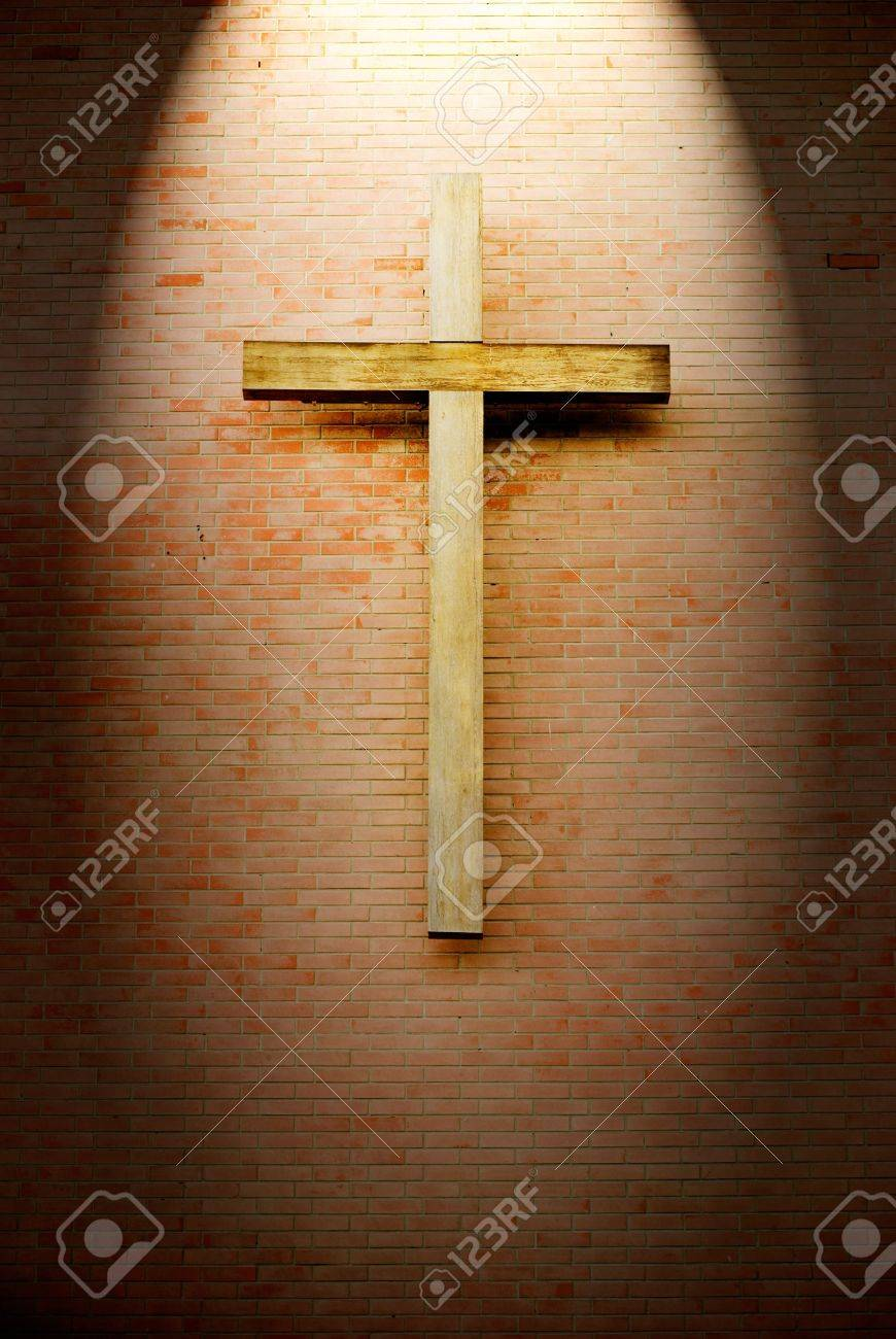 Wooden crucifix on the brick wall lighting by spotlight stock photo wooden crucifix on the brick wall lighting by spotlight stock photo 10044164 biocorpaavc Choice Image