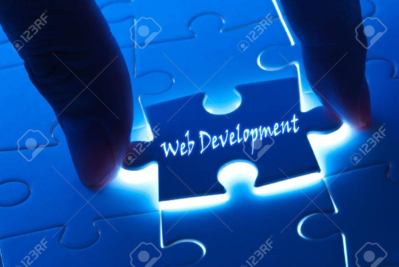 Web development word on puzzle piece with back light Stock Photo - 11743139